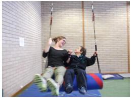 teacher and student enjoy Sensory Gym