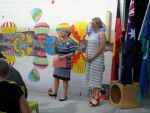 Principal, Sue Roche and Artist Clare Thackway in front of balloon mural